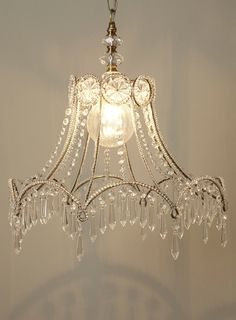 I can't find the original source for this light fixture, but it appears to be a very upcycled lamp shade.