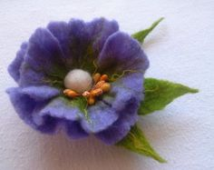Blue turquoise White felted flower. Handmade from 100% pure merino wool which is hand washed, brushed and colored.  On the back hair clip and brooch pin.  Dimensions: 17 cm (6.6)  100% natural and eco friendly. All Made with Wet Felting process. It will cheer you up no matter how you wear it : pinned to your bag, coat, dress, hat or a scarf.  If you have any questions, please contact us! :) Handmade with love and care.