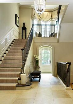 entrance hall with multiple staircases