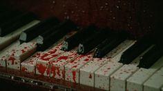 Blood splattered everywhere, turning the ivory keys crimson