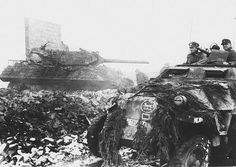 German soldiers of Panzer-Division 'Windhund' in a Sd. passing by a destroyed Tank Destroyer during the Battle of Hürtgen Forest, in the town of Schmidt, North Rhine-Westphalia, Germany. M10 Tank Destroyer, Willys Mb, Luftwaffe, M10 Wolverine, Military Armor, Ardennes, Armored Fighting Vehicle, Ww2 Tanks, German Army