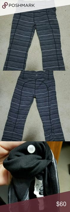 Lululemon crops Excellent used condition Lululemon Gather & Crow crops in size 10 (size dot confirmed). Rip tag still intact. Really cute print! Lululemon has discontinued this line. lululemon athletica Pants Leggings