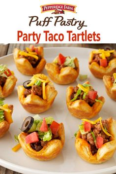 "Puff Pastry Party Taco Tartlets Recipe. Hello, Taco Tuesday! Add some spice to your next party with bite-sized tacos in Puff Pastry tartlets. Finish them with your favorite toppings, or let your guests top their own at a fun ""Fill-Your-Own Taco Bar"". We filled ours with a classic mix of taco-seasoned ground beef, shredded cheddar cheese, lettuce, tomatoes, and olives. They're also delicious with your favorite taco fillings like shredded chicken, diced avocado, sour cream, cilantro and lime."