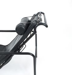 Gabriele Mucchi. Rare all black Genni chaise designed in 1935 by Gabriele Mucchi for Zanotta. This early piece has still got the original cushions and headrest, the frame is made from black tubular steel whereas the armrests are covered in leather also. Very elegant and comfortable adjustable (in height) lounge chair in very good vintage condition with wear to the armrests and leather.