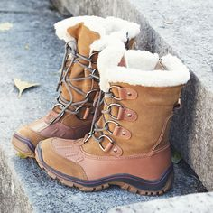 Keep your feet cozy in suede snow boots.