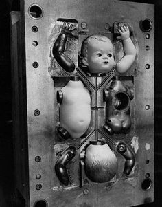 Parts of the Patsy dolls In the injection mold, at the factory of Cascelloid Ltd, 1951. by Kurt Hutton. S)