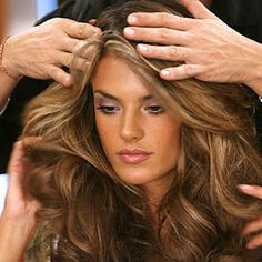 The secrets to getting Victoria's Secret model hair. Time to invest in velcro rollers. lol