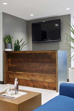 New York office reception area reclaimed wood and steel desk