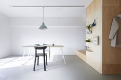 The apartments' existing partition walls were removed leaving neutrally decorated, open-plan living spaces.