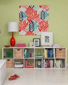 Canvas Chic    Pick up a large fabric stretcher and some fun fabric (look for bright and bold prints). Stretch the fabric over the frame and secure with a staple gun for a customized yet inexpensive statement piece #homesecuritydiyspaces