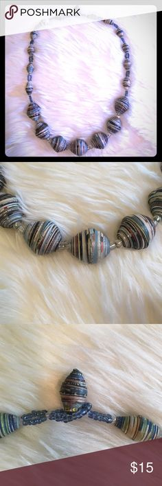 """African Necklace This necklace was made and bought in Africa. Beads are made with pieces of magazine scraps and range from .5"""" to 1"""" in size. Necklace is 20"""" long when open. Jewelry Necklaces"""