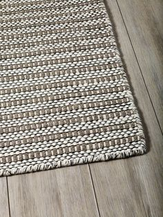 A beautifully textured flatweave rug made from 100% wool in natural colourways and minimalistic patterns. Durable and ideal for high traffic areas and famil