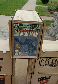 Iron Man comic book displayed in a clear acrlic frame. Attached to a comic storage box. Get one at the Phoenix Comicon booth Comic Book Storage, Comic Book Display, Nerd Cave, Man Cave, Comic Book Rooms, What Makes A Hero, Phoenix Comicon, Iron Man Comic Books, Hobby Room
