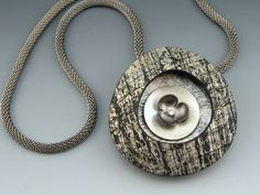 Etched polymer window pendant with sterling and vintage flower details by Stonehouse Studio