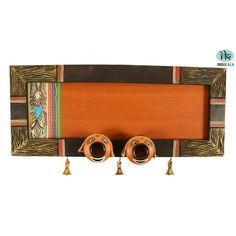 This ethnic nameplate is made out of mango wood . Nazar Bhattu's are a proven technique to ward off evil spirits and keep one's home, kith and kin, safe and well. When placed at the entrance, this name plate accords a classy yet traditional look to your house.  Buy Now at Indikala - http://www.indikala.com/featured-products/wooden-panelled-name-plate-with-nazar-bhattus.html  #Name #Buy #House #Homedecor