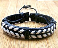 personalized  dark leather bracelets wristband with  white and dark rope  for men women with  adjustable length. $3.50, via Etsy.