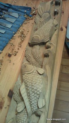 fish carving. Pinned from a blog. No source of artist.