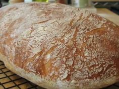 No-Knead Ciabatta    Ingredients:  4 cups bread flour (I used 3 1/2 cup white and 1/2 cup wheat)  *Note: you can use All-purpose flour if you want  1/4 tsp yeast  2 cups water  1 1/2 tsp salt