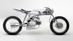 With an alien aesthetic that could have come from H.R. Giger's own sketchbook, Bandit9's AVA motorcycle reflects a highly polished approach to minimalism. The Vietnam-based builder Daryl Villanueva and his team construct the limited-edition model from a 1967 Honda Supersport (with a 125 cc engine) and then handcraft the distinctive steel unibody tank and X cowl, as well as customize the front suspension, steel exhaust, brake light, speedometer, and leather seat, and reflective chrome finish…