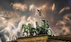 Fireworks explode next to the Quadriga sculpture on the Brandenburg gate during New Year celebrations in Berlin, Germany.
