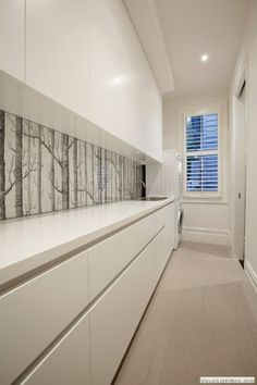 For an alternative splashback use wallpaper. Place glass in front to avoid it getting ruined. Cole & Son Woods