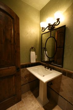 check out this powder rooms interesting mirror