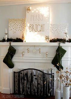Several cute ideas on this mantel: 1. The canvas with fairy lights poked through on the corners and 2. Ornaments suspended from the under side of the mantel. What else?