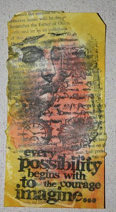 LaBlanche and Tim Holtz stamps with Distress Inks over book page background.
