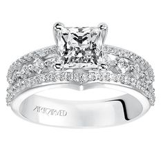Diamond engagement ring with round center stone and diamond enhanced band. Style: Lauren #ArtCarvedBridal