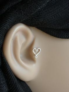Infinity Heart Silver bio flexible Tragus by PiercingRoom on Etsy. $10.95, via Etsy.