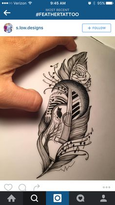 Music themed feather tattoo