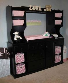 Baby changing station from entertainment center.