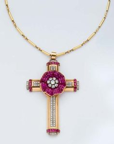 A RETRO RUBY, DIAMOND, GOLD AND PLATINUM PENDANT NECKLACE, BY KIRBY BEARD & Co, circa 1943 [Retro cross is certainly different]