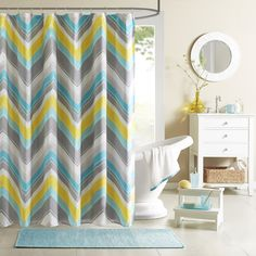 The Intelligent Design Ariel Shower Curtain provides a modern update for the stylish customer. Its updated chevron design uses two shades of blue along with a pop of yellow and grey to update your space instantly.