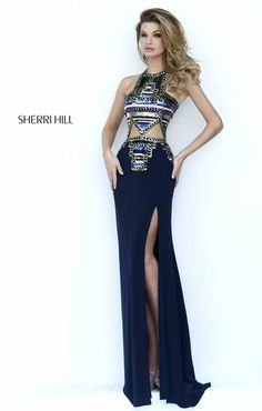 This dress is so beautiful ! Would have gotten it for my prom but it was a little too pricey but gorgeous Sherri Hill dress !