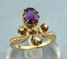 This is a stunning gorgeous vintage/ antique ring features a 1.10 ct amethyst with 4 round cut diamonds set in 14k yellow gold mount.