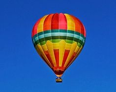 I see a hot air balloon every Wednesday morning on the way to work and it always makes me smile, though I don't know why.