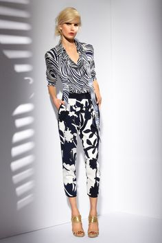 ESCADA Resort 2013 - Inspired by the artist Alphonse Mucha and created in-house by ESCADA, this swirling pattern is one of the season's key prints - here in a superb pure silk blouse with detachable scarf paired with loose-legged fit, slip-on elastic waistband and cool rounded hems