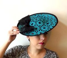 Black Sinamay Saucer With Bow And Laser Cut Teal Fabic  BY AMANDA G. JOYNER  #millinery #hats #HatAcademy