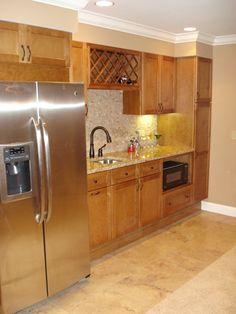 Basement Bar | Basement bar with full fridge, microwave, wine rack, undercabinet ...