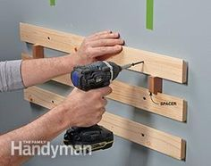 Screw on the wall cleats, then hang the garage shelving bins.