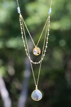 This extra long necklace is EXTRA fun; it has the effect of several layered necklaces but its really only one. Wire-wrapped pyrite chain grabs