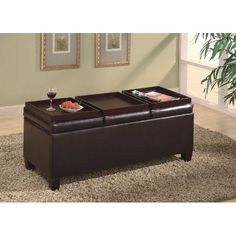padded coffee table with extra storage and seating