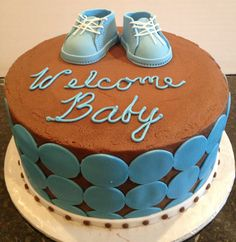 Baby boy baby shower cake with baby booties.