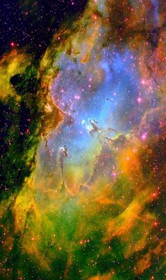 The Eagle Nebula is part of a diffuse emission nebula, or H II region. This region of active current star formation is about 7000 light-years distant. Several spires of gas that can be seen coming off the nebula.The descriptive names reflect impressions of the shape of the central pillar rising from the southeast into the central luminous area