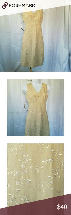 """ANN TAYLOR TAN  SILK BLEND EMBROIDERED DRESS 0 ANN TAYLOR LOFT BEAUTIFUL TAN LINEN AND SILK BLEND EMBROIDERED DRESS.  This tan dress is embroidered with cream flowers and leaves.  It has a v neck and modified empire waist and a hidden zipper.  Fully lined. A line style.  Size 0. Armpit to armpit is 16"""" and shoulder to hem length is 36"""". On trend and professional for your work week! Ann Taylor Dresses Midi"""