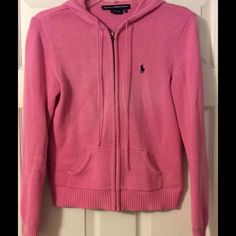 Ralph Lauren Polo pink hooded sweater This Ralph Lauren Polo pink full zip sweater is of medium weight with a drawstring hood, navy blue signature logo horse and hits around the hips, running true to size. It is in very good preowned condition with minor wear and comes from a pet free, smoke free home. Reasonable offers will be entertained. Ralph Lauren Sweaters Cardigans