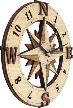 Compass clock in wooden - Wind rose - Windrose -.- Windrose Compass Clock within the Wind Rose Wooden Magnetic Compass, Cardinal Directions, Deco Cool, Wind Rose, Nautical Chart, Rose Wall, Diy Clock, Wood Clocks, Wood Carving