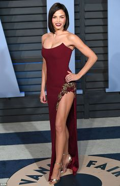 Jenna Dewan Tatum held her own on Sunday night, heating up the Vanity Fair Oscar party red carpet in Beverly Hills in a red gown that showed plenty of the mother-of-one's skin.