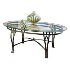 ??? Maybe - Steve Silver Madrid Oval Glass Top Coffee Table